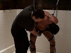 Puppy begins by tieing the slave to two points of chain from the moist room ceiling, then claws up the slave's body. Puppy then uses various impact implements on the slave's ass earlier than jerking and torturing the slave's cock and balls with his hands