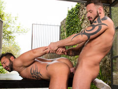 In a country field, Martin Mazza and Antonio Miracle are stripped to the waist, engaged in a spirited round of have fun fighting. Gaining the upper hand, Martin grabs the front of Antonio's tight shorts and pulls them down, revealing Antonio's pulsating c