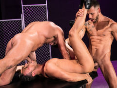 Naked except for their ebony leather boots, three horny men indulge their primal urges. Hairy bodybuilder Bruce Beckham and tatted FX Rjos stand over smooth Josh Conners, who is crouching with his spread waste cheeks in the air. Bruce and FX take turns ri daddy gay porn