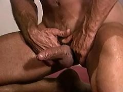 Three guys exchanging oral caresses