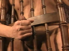 Sexy and hot Stud jerk off his meat behind a woody chair