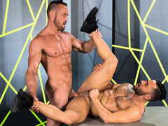 Tattooed Bruno Bernal lifts his chin to kiss towering Myles Landon. A light dusting of hair spreads across Bruno's bulging pecs, and his abs ripple as he kneels. Myles is a smooth, muscled bodybuilder; his nips are erect and his massive cock twitches wi daddy gay porn