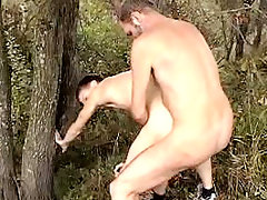 Old gay man sucks cute boy's cock and fucks him from behind in the woods