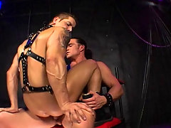 Two hot leather studs fucking and sucking in a dungeon daddy gay porn