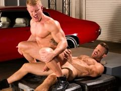 Huge muscled torsos of Johnny V and Landon Conrad compare to the muscle cars in the Auto Erotic Shop. And Johnny's smooth muscled chest contrast daddy gay porn